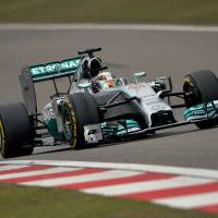 Hamilton wins third straight race in Shanghai
