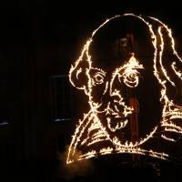 A depiction of William Shakespeare is lit up during a firework display by the Royal Shakespeare Company on Wednesday to mark the 450th anniversary of his birth in Stratford-upon-Avon in southern England. | REUTERS