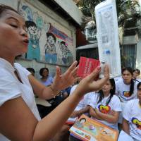 Top Philippine court approves contentious birth control law