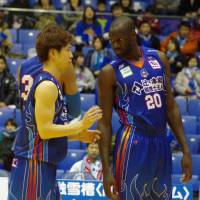 Valuable leader: Aomori Wat's forward/center Stanley Ocitti (right) provides the expansion team with on-court productivity and leadership. The Wat's are vying for a playoff spot in their first season. | HANA SUZUKI