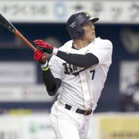 Still an issue: The Buffaloes' Yoshio Itoi, seen hitting a sixth-inning home run on Thursday, and other NPB players are playing the game with a lively ball that has exceeded maximum limits set by the NPB. Testing was done on March 29. | KYODO