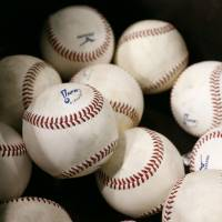 A stack of official NPB baseballs.  | KYODO