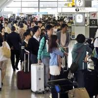Vacationers heading abroad pack the departure lobby of Narita International Airport in Chiba Prefecture on Saturday as the Golden Week period kicked off. | KYODO