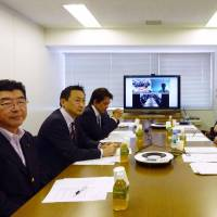 Members of Nippon Ishin no Kai (Japan Restoration Party) discuss its future course Saturday at its headquarters in Tokyo. | KYODO