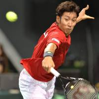 Back to you: Japan's Yasutaka Uchiyama returns a shot against the Czech Republic's Lukas Rosol during the Davis Cup World Group quarterfinals on Sunday. | AFP-JIJI