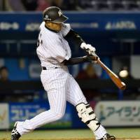 Big blast: The Marines' Toshiaki Imae belts a long home run in the second inning against the Eagles on Friday at QVC Marine Field. | CHIBA LOTTE DEFEATED TOHOKU RAKUTEN 4-3.