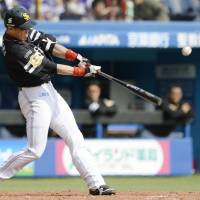 Big bat: The Hawks' Seiichi Uchikawa hits a two-run home run in the fourth inning against the Marines on Saturday. Uchikawa had two homers in Fukuoka Softbank's 6-1 win over Chiba Lotte. | KYODO