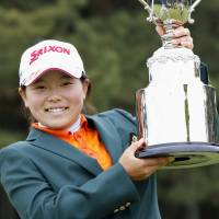 Youth movement: Teenage amateur Minami Katsu holds the trophy after winning the Vantelin Ladies Open on Sunday. | KYODO