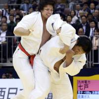 Back on top: Daiki Kamikawa (right) throws Ryu Shichinohe at the national invitational weight-class judo championships in Fukuoka on Saturday. | KYODO