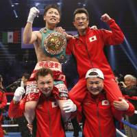 Moment to savor: Naoya Inoue (top left) celebrates with his father, Shingo, after defeating Adrian Hernandez of Mexico for the WBC light flyweight title on Sunday. | REUTERS