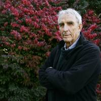 Writer Peter Matthiessen stands in the yard of his house in Sagaponack, New York, on Oct. 28, 2004. The world-renowned naturalist, explorer, Buddhist teacher, political activist and award-winning author of more than thirty books died Saturdayafter an illness of some months, his publisher said. | AP