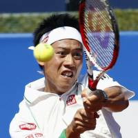Feeling just fine: Kei Nishikori hits a return against Andrey Golubev during their match at the Barcelona Open on Thursday. Nishikori won 6-0, 6-4. | KYODO