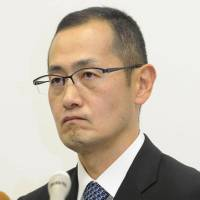 Kyoto University Prof. Shinya Yamanaka faces reporters Monday in Kyoto. Yamanaka denied that any data or images were improperly manipulated concerning his 2000 paper. | KYODO