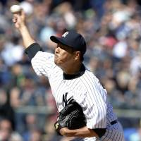 Despite shaky outing, Kuroda improves to 2-1