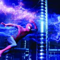 Sticky situation: Spider-Man (Andrew Garfield) battles Electro (Jamie Foxx) in 'The Amazing Spider-Man 2.' © 2013 CTMG. | ALL RIGHTS RESERVED.