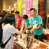 Cheers!: Visitors sample drinks at last year's Microbrewery Beer Festa in Hiroshima.