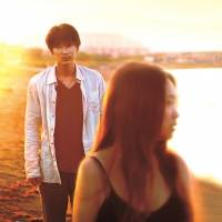 An escape: The turbulent relationship between Chinatsu (Chizuru Ikewaki) and Tatsuo (Go Ayano) is consummated after a wander along an empty beach near Hakodate, a port town in Hokkaido. | © 2014 SATO YASUSHI /