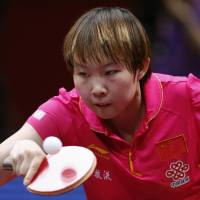 China's Zhu Yuling hits a return to Singapore's Isabelle Li Siyun during their women's semi-final match Sunday at the World Team Table Tennis Championships in Tokyo.
