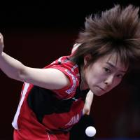 Japan's Kasumi Ishikawa serves to Hong Kong's Jiang Huajun during their women's semi-final match Sunday at the World Team Table Tennis Championships in Tokyo.