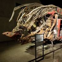 The remains of a New York City fire truck are displayed at the National September 11 Memorial Museum on Wednesday. | AP