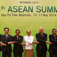ASEAN leaders have their photo taken during the opening ceremony of the 24th ASEAN summit in Naypyitaw, Myanmar's capital, on Sunday. | REUTERS