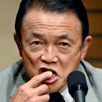 Aso complains his taxes shouldn't be used to fund health costs of 'lazy'