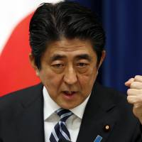 Prime Minister Shinzo Abe speaks at a news conference at his official residence in Tokyo on Thursday. | REUTERS