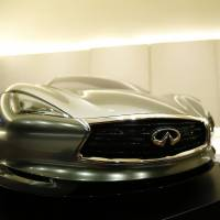 Infiniti chief designer Alfonso Albaisa is interviewed Tuesday at the Nissan Technical Center in Atsugi, Kanagawa Prefecture, behind a quarter-sized model of the Emerg E car.   REUTERS
