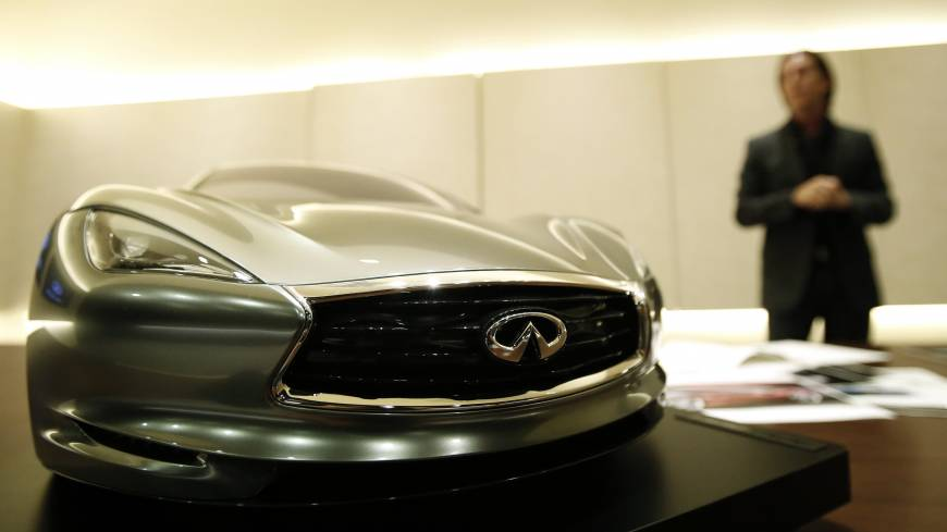Infiniti chief designer Alfonso Albaisa is interviewed Tuesday at the Nissan Technical Center in Atsugi, Kanagawa Prefecture, behind a quarter-sized model of the Emerg E car.