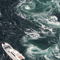Whirlpools churning in the Naruto Strait are seen March 1. | KYODO