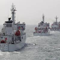 Taiwan Coast Guard patrol ships take part in a drill northwest of Kaohsiung in March 2013. Taiwan is building a $100 million port next to an airstrip on Itu Aba Island in the disputed South China Sea. | REUTERS