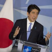 Prime Minister Shinzo Abe attends a news conference at NATO headquarters in Brussels on Tuesday. | AP