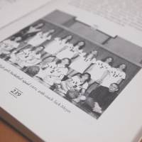 "Dark history: One of the remaining copies of ""The American School in Japan: A History of Our First Century"" shows teacher Jack Moyer with the girls' basketball team he coached in 1971. Copies of the book were destroyed after Janet Simmons, a former ASIJ student who was abused by Moyer in the early 1970s, confronted staff about the book, which praises Moyer. 