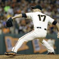 Another strong outing: San Francisco's Tim Hudson throws a pitch in the sixth inning against San Diego on Wednesday night. The Giants edged the Padres 3-2. | AP