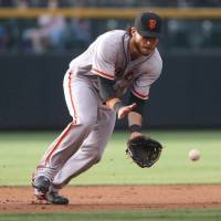 Pence, Sandoval, Crawford blast Giants past Rockies