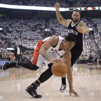 Balance: Toronto's DeMar DeRozan drives past Brooklyn's Deron Williams in the first half of Game 5 on Wednesday night. The Raptors beat the Nets 115-113 and lead the series 3-2. | AP