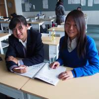Positive peer pressure: 'I see I can make a change, so I want to use my English skills to help my friends who are native Japanese speakers,' says returnee Erina Yoshii (right). 'I want them to enjoy learning English.' | YUI KOBAYASHI