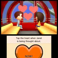 A screenshot of two characters falling in love in Nintendo's 'Tomodachi Life' simulation game | AP