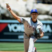 You got it: Rangers starter Yu Darvish delivers a pitch against the Angels on Sunday in Anaheim, California. Texas beat Los Angeles 14-3 to give Darvish his second victory of the season. | KYODO
