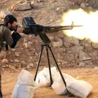 A rebel fighter fires in the direction of regime forces during clashes in the Sheikh Najar area of the restive Syrian city of Aleppo in February. | AFP-JIJI