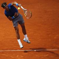Serena, Nadal advance with minimum of fuss