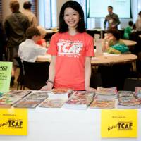 Flipping through: A volunteer staffs an area for children at last year's Toronto Comic Arts Festival. | PAUL HILLIER