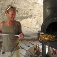 From the ground up: Dennis van den Brink makes a pizza with fresh vegetables in his stone oven at Niseko Green Farm.   | NISEKO GREEN FARM