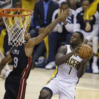Midair meeting: Indiana's Lance Stephenson goes up for a shot against Miami's Rashard Lewis in Game 5 on Wednesday night. The Pacers beat the Heat 93-90 and trail 3-2 in the series. | AP