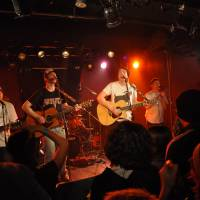 Live circuit: Jimmy Binks and The Shakehorns perform for a crowd at Club Edge in Tokyo on March 21.  | E.H. TIERNAN