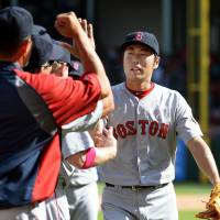 Nice work: Red Sox closer Koji Uehara is congratulated by his teammates after converting the save in Sunday's 5-2 victory over the Rangers. The save was Uehara's ninth of the season. | KYODO