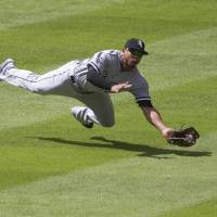 Shadow play: Chicago outfielder Moises Sierra makes a diving catch against Houston in the second inning on Saturday. | AP