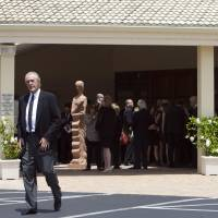 Final respects: Miami Heat president Pat Riley leaves Saint John the Evangelist Church on Thursday following the funeral service for Hall of Fame coach Jack Ramsay. | AP