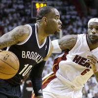 Tough to shake: Brooklyn's Marcus Thornton drives on Miami's LeBron James in the second half of Game 2 on Thursday night. | AP