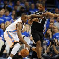 Surge protector: Thunder forward Serge Ibaka (left) competes against the Spurs' Boris Diaw during the fourth quarter of Game 3 of the Western Conference finals in a photo provided by USA Today on Sunday. The Thunder won 106-97. | REUTERS